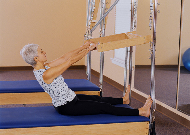 USA --- Woman Practicing Pilates --- Image by © ROB & SAS/Corbis